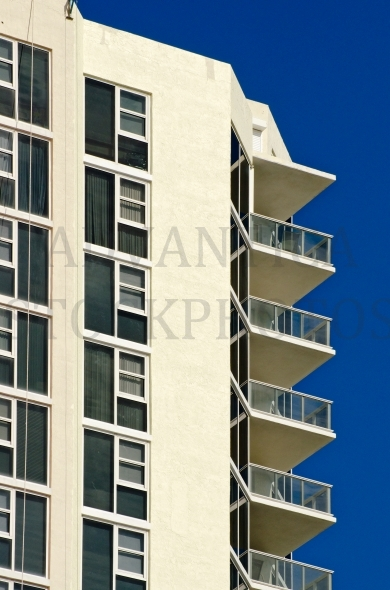 Apartment balconies against deep blue sky