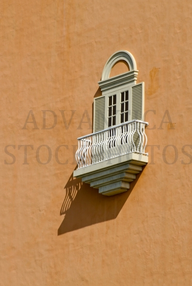 Ornate window with shutters and balcony