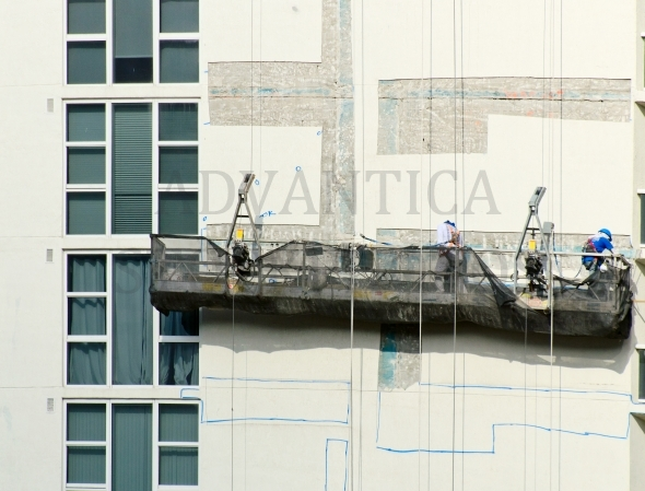 Workers on the scaffolding