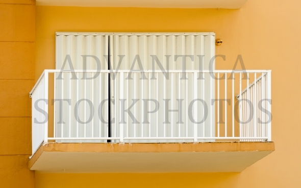 Balcony on orange wall