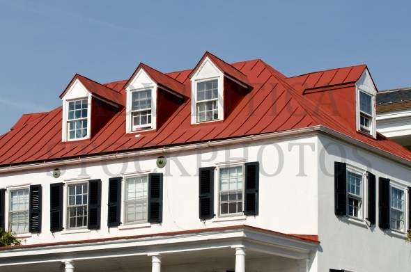 House with red roof and four dormer windows
