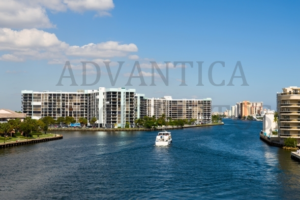 Boat and highrise buildings in Hollywood Beach in Florida