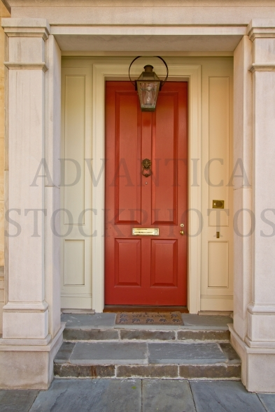 Tall red house entrance door