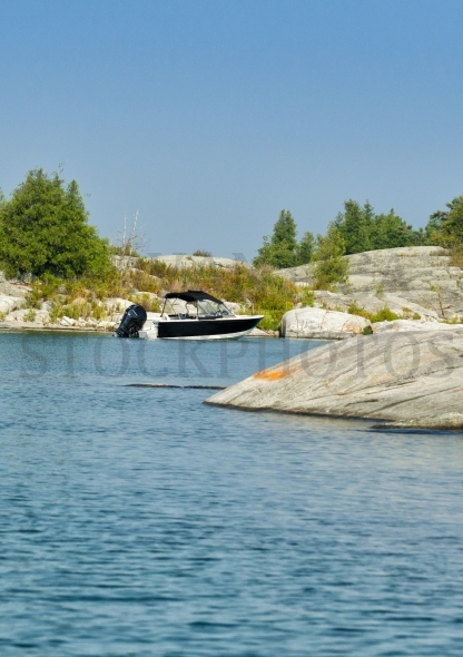 Motor boat at a rocky island