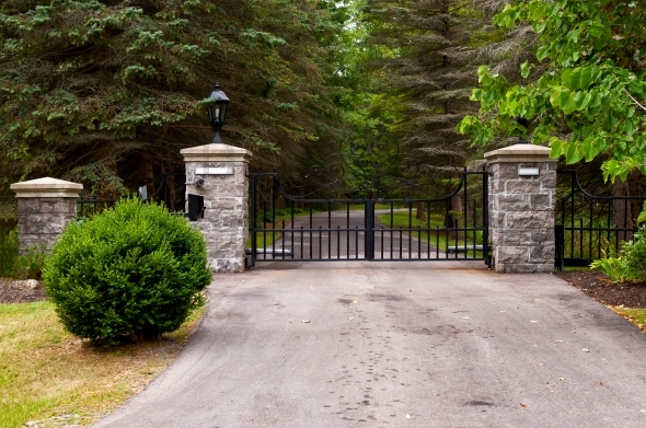 Impressive property entrance gate with brick columns