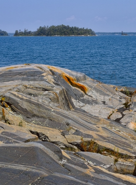 Gneissic rock formations with colorful veins