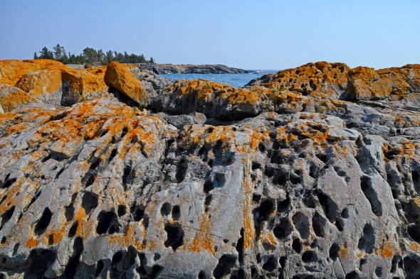 Erosion and red moss on ancient rock formations