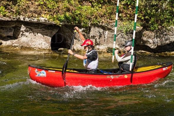 Two men in a whitewater canoe