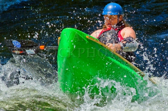 Coming Through – Man paddling whitewater canoe