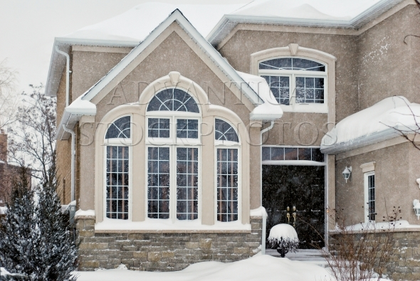Contemporary house in a winter blizzard
