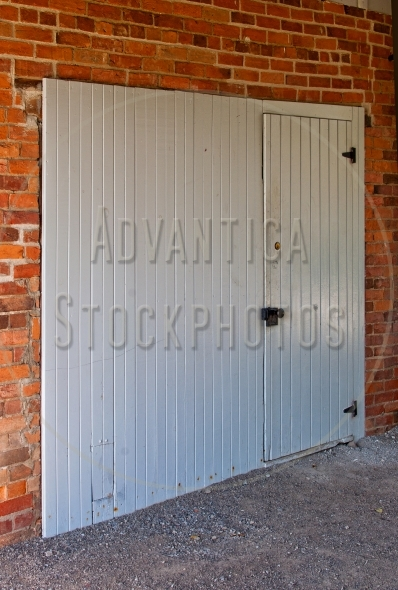 Wooden door on a red brick wall