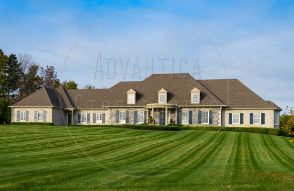 Large luxury bungalow home on manicured lawn