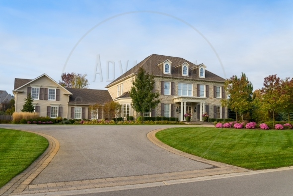 Large luxury home with nice landscaping