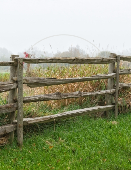 Old split-rail fence in the morning mist