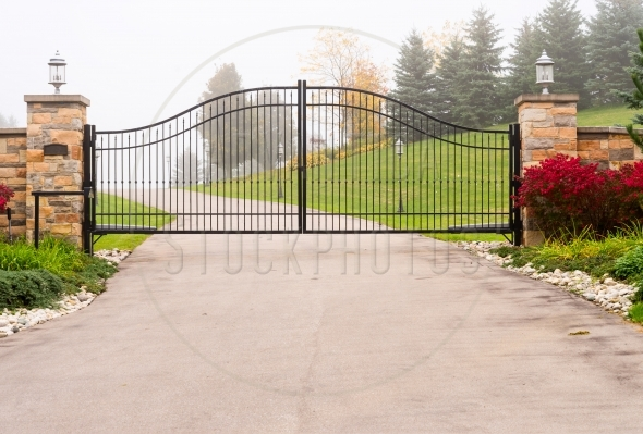 Wide metal wrought-iron gate