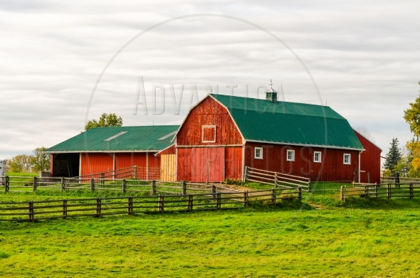 Red barn and a horse corral
