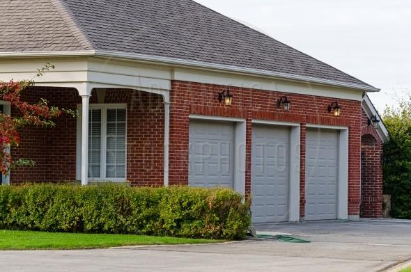 Red brick triple garage
