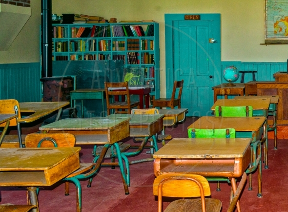 Vintage classroom with podium and pupil desks