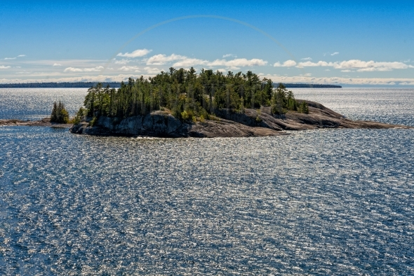 Island and glittering water in Lake Superior