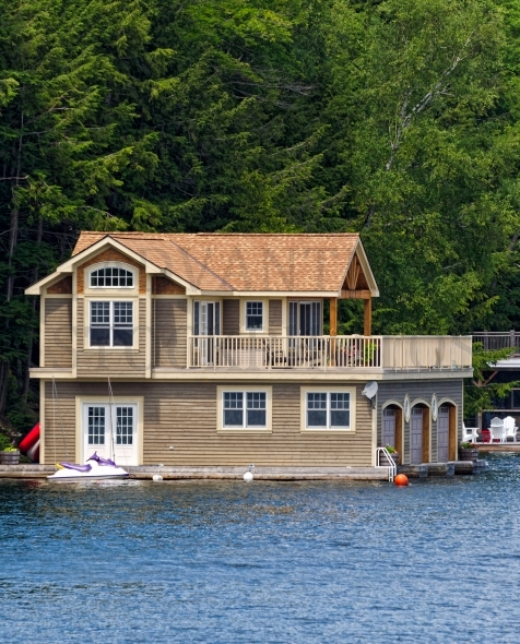 Luxury boathouse with living quarters and balcony