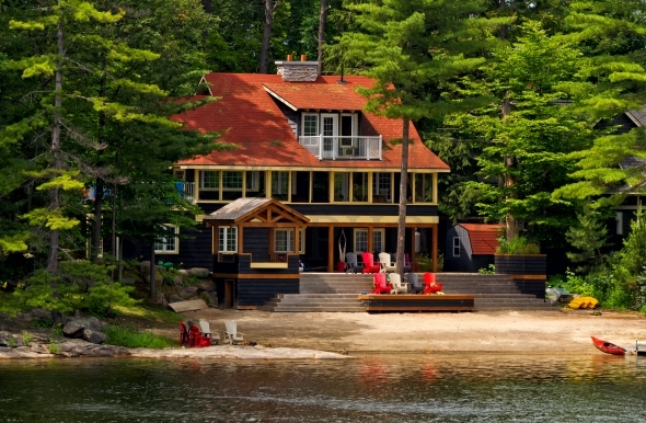 Cottage with a red roof and beach
