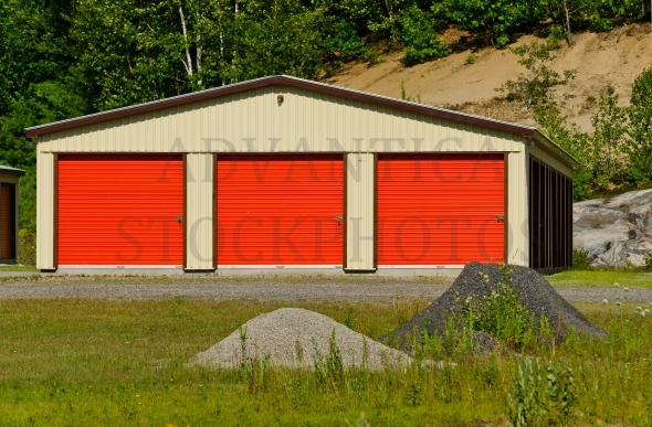 Storage building with three orange doors