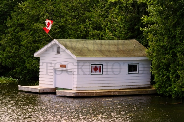 Boathouse With Canadian Flag – Stock image by Les Palenik