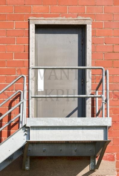 Stairway to a metal door