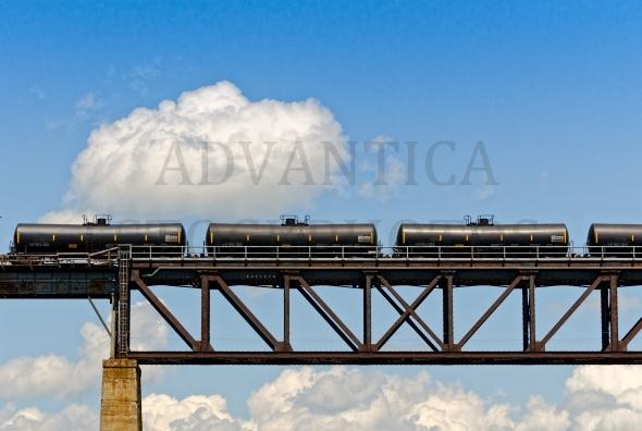 Train cars on a railway bridge