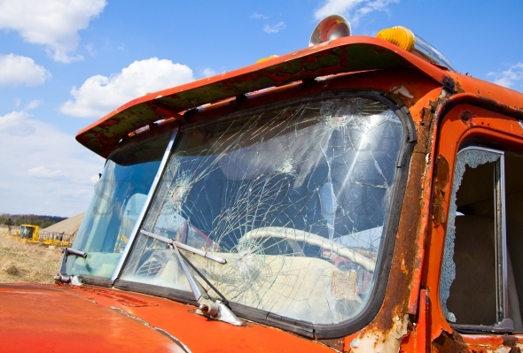 Old truck with a broken windshield